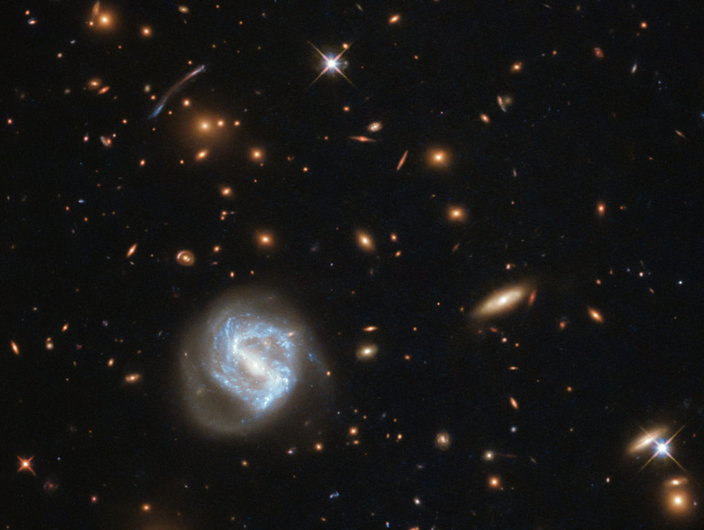 A Galaxy Cluster is predicted to have a certain amount of dense Dark Matter around it.
