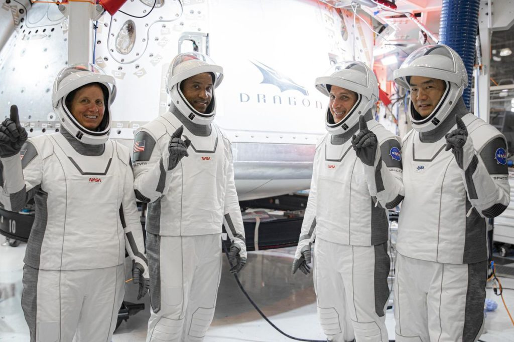 From left to right, NASA astronauts Shannon Walker, Victor Glover, and Mike Hopkins, along with Japanese astronaut Soichi Noguchi. Image Credits: NASA