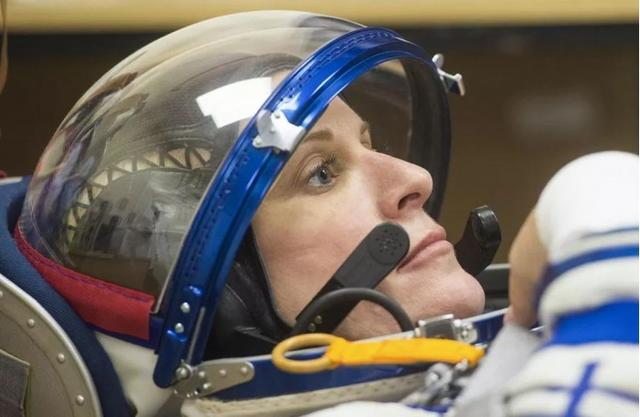 NASA astronaut Kate Rubins in her flight suit ahead of launch.