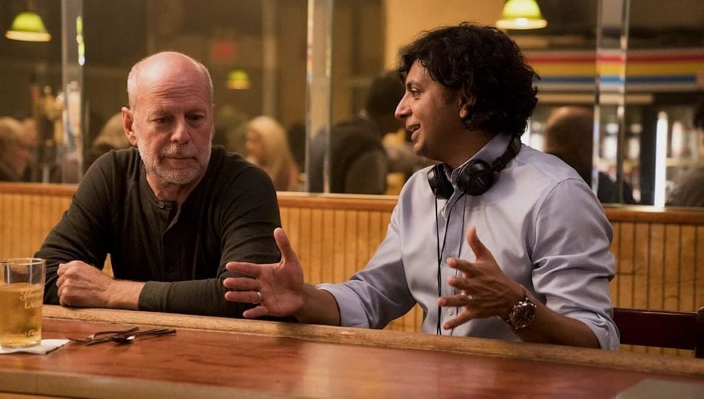 Shyamalan directing Bruce Willis in Glass